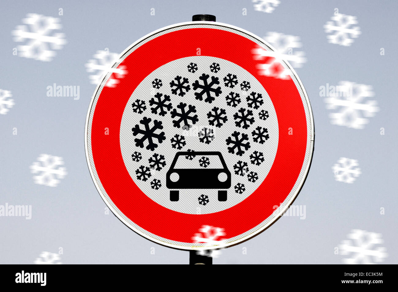 Traffic sign heavy snowfall, photo montage - Stock Image