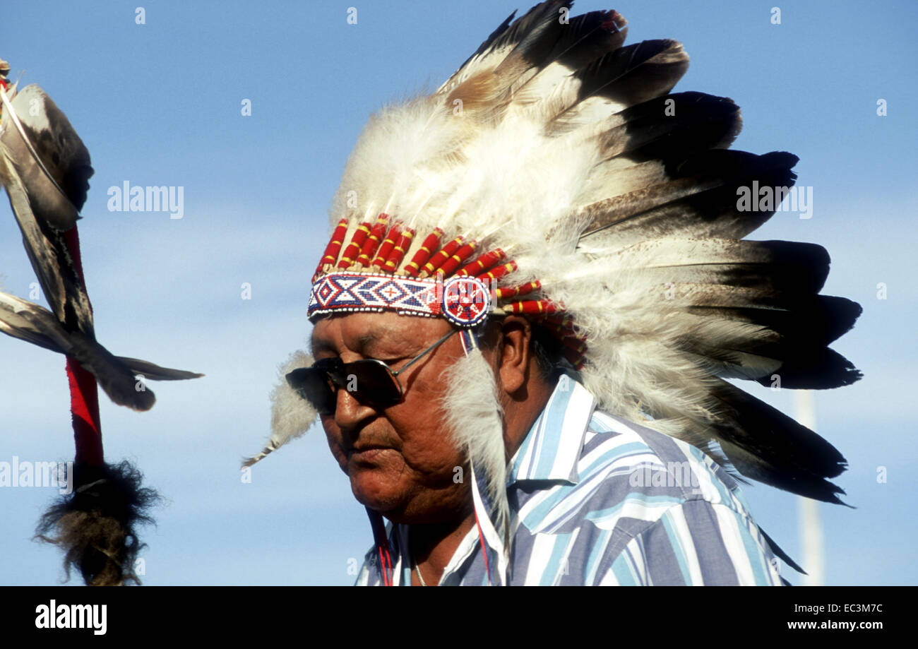 Lakota Chief with Feathered Headdress and Sun Glasses - Stock Image