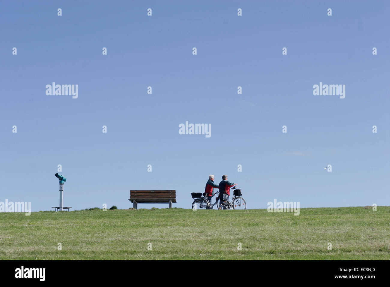 2 Persons with Bicycle - Stock Image