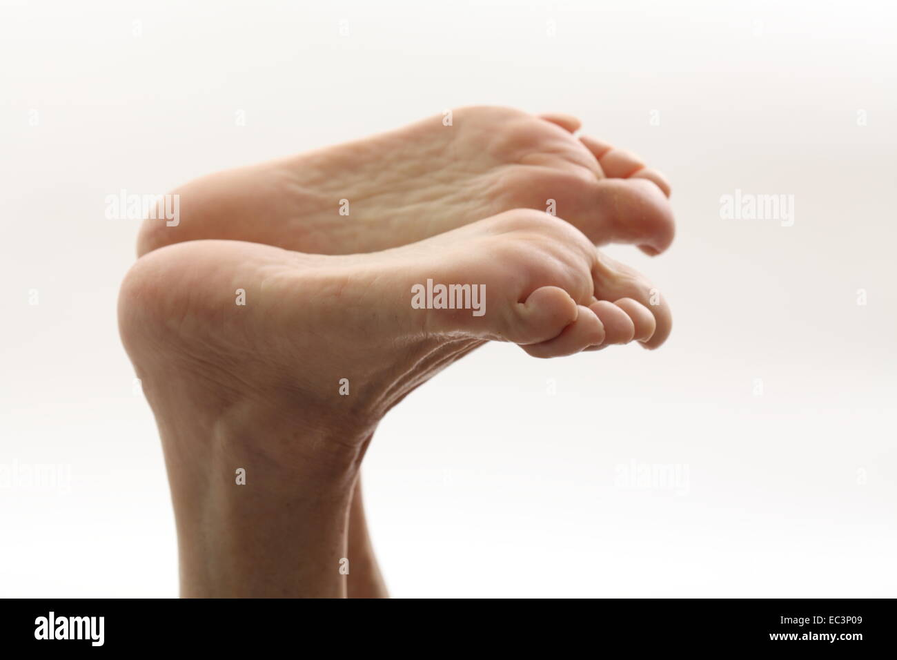 Soles of a woman in front of white - Stock Image