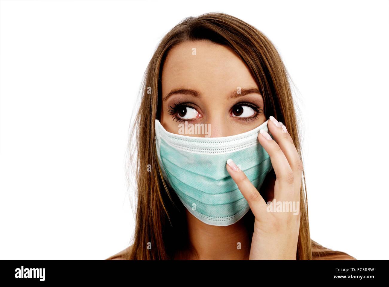 Woman with medical mask, swine influenza - Stock Image