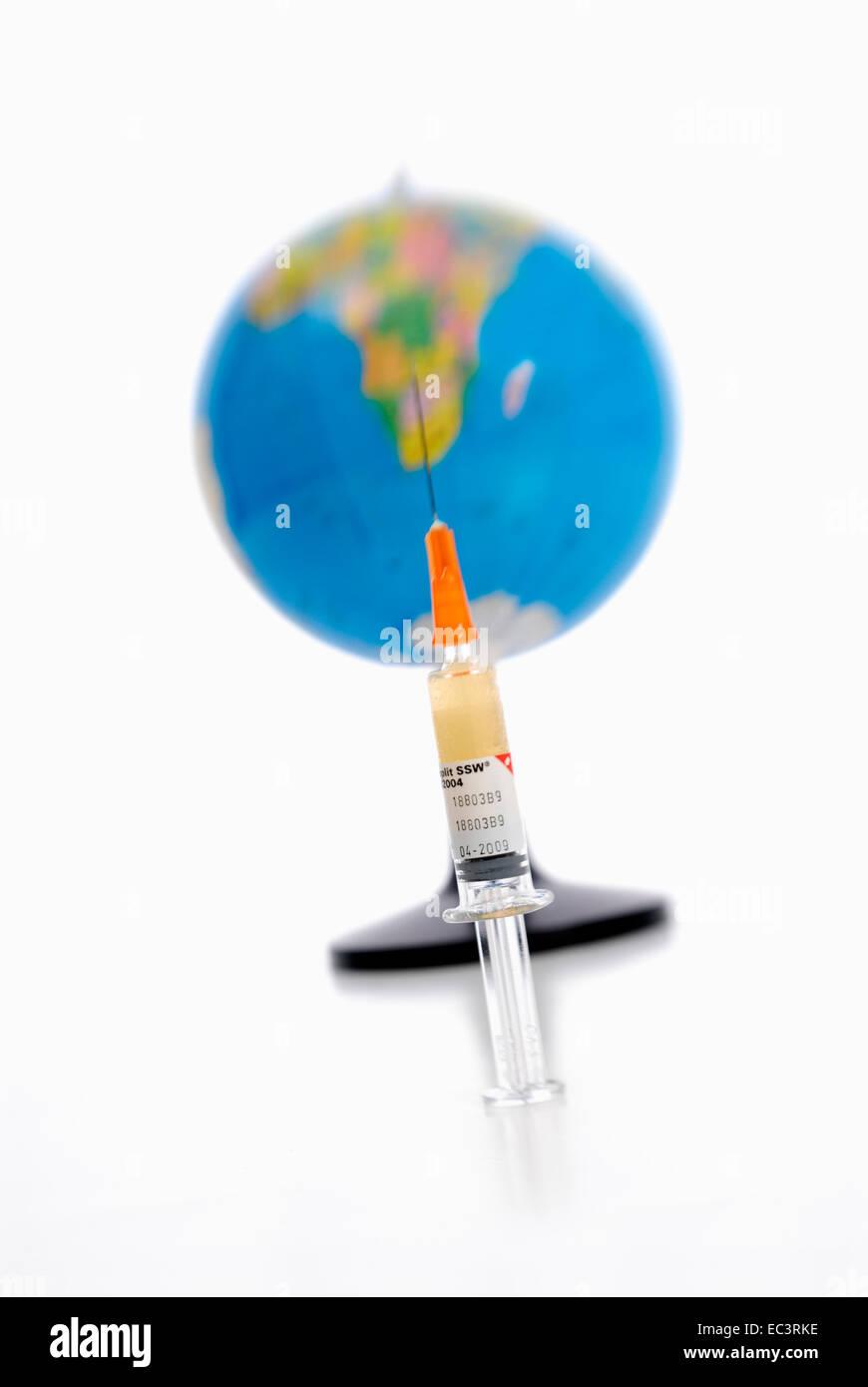 Syringe and globe, inoculation against swine influenza - Stock Image