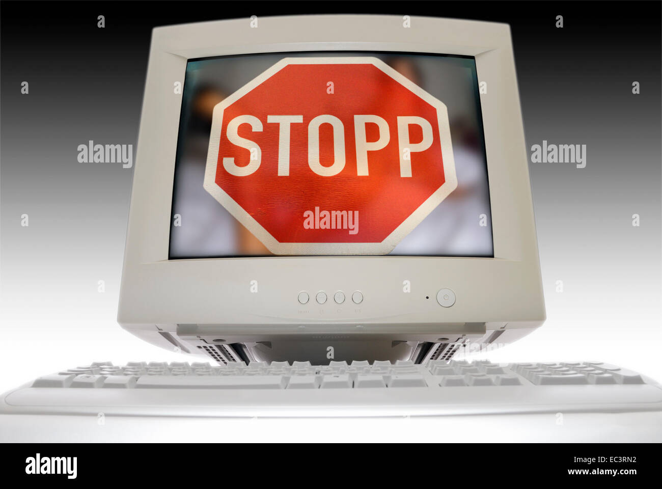Computer monitor and stop sign, illegal websites - Stock Image