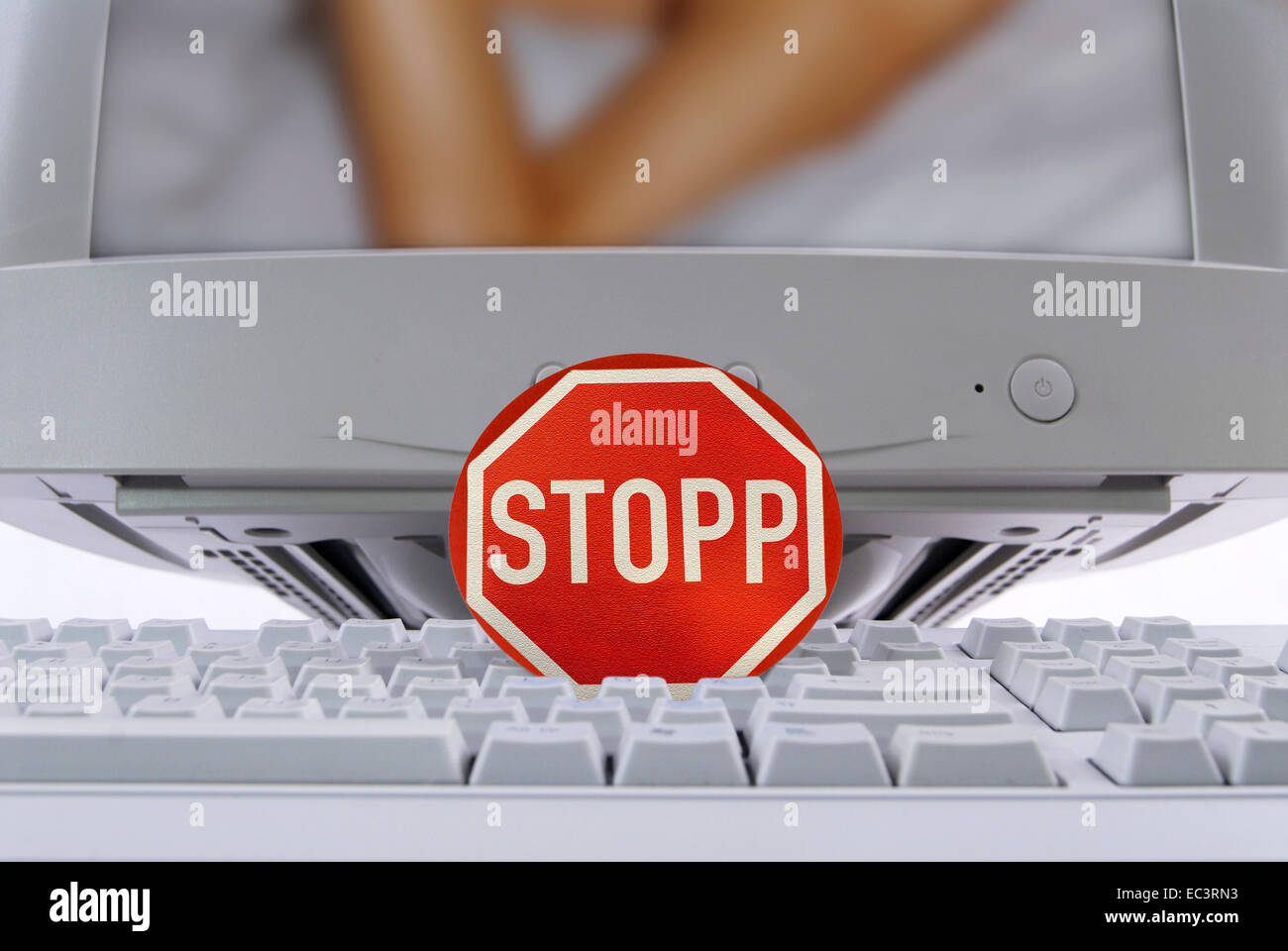 Computer and stop sign, illegal websites - Stock Image