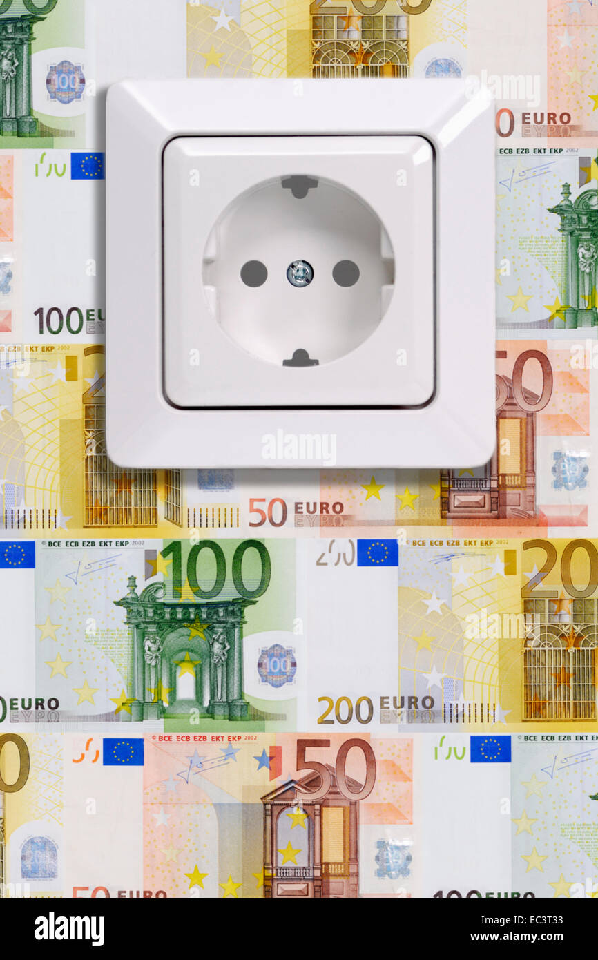Power socket and wall with banknotes, energy consumption costs - Stock Image