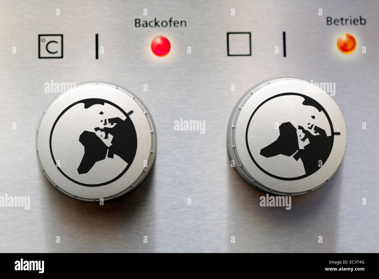 Adjusting knob of an oven with globe, global warming - Stock Image