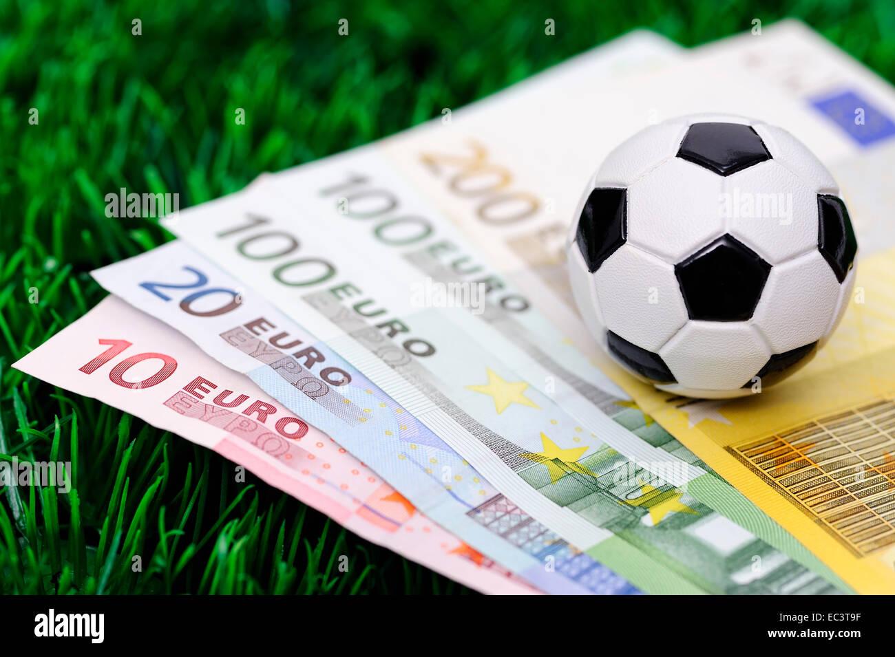 Soccer ball on euro banknotes Stock Photo