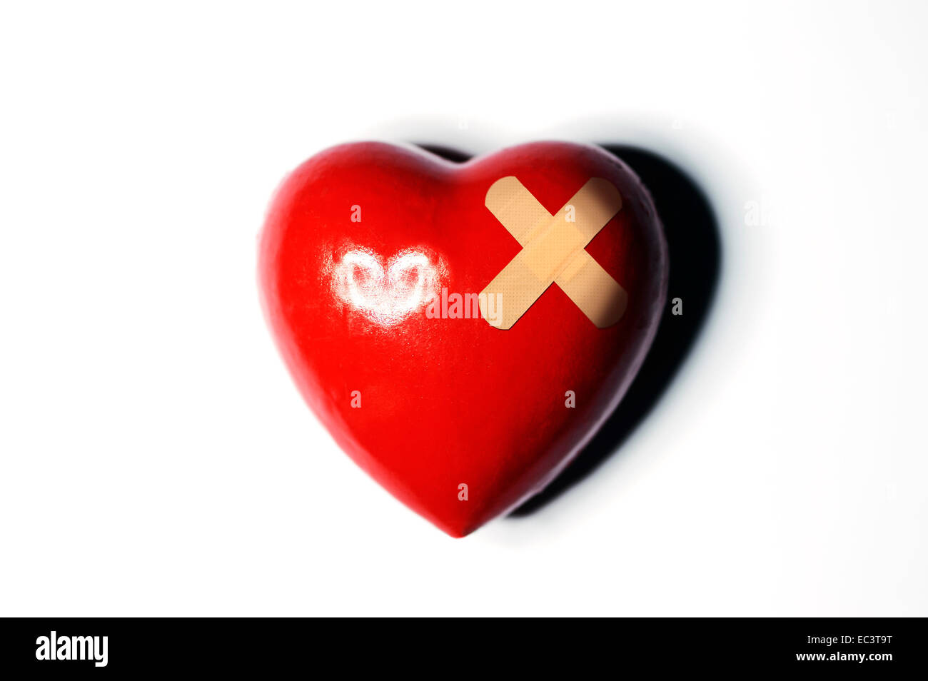 Red heart with band-aid - Stock Image