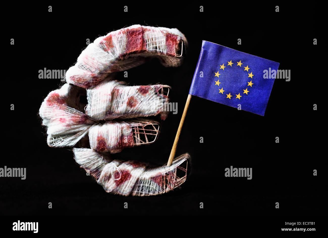 Bloody euro sign and EU banner, debt crisis - Stock Image