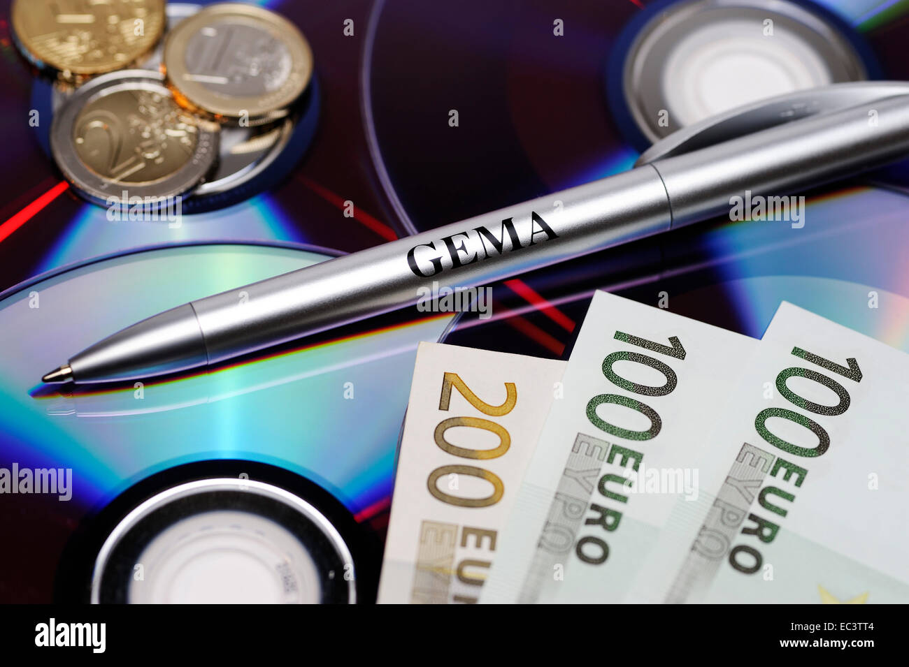 Compact discs, euro banknotes and GEMA pen - Stock Image
