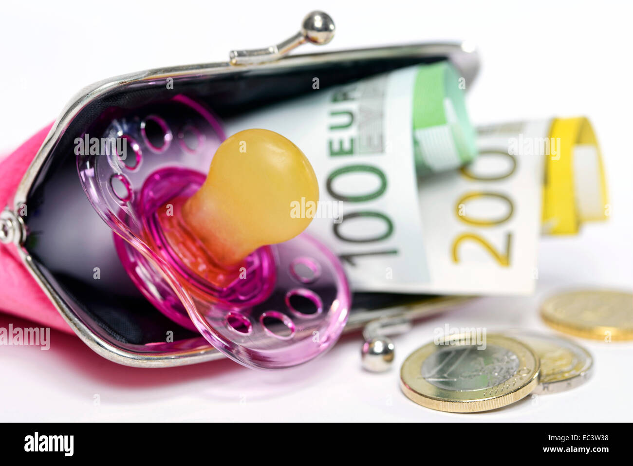Comforter, purse an euro banknotes, child care subsidy - Stock Image