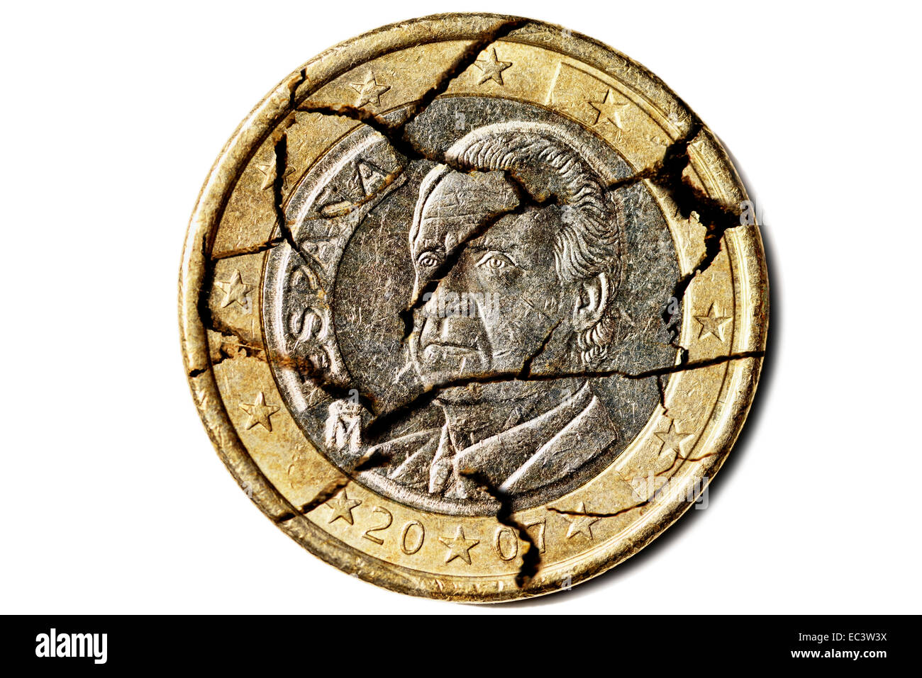 Spanish one euro coin with cracks, debt crisis in Spain - Stock Image