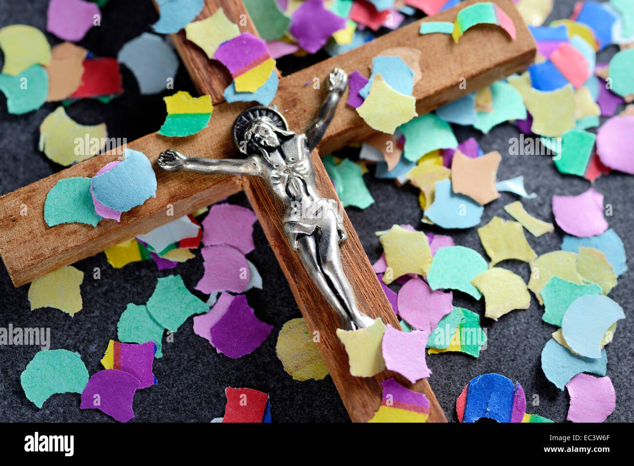Cross and colourful confetti, Catholic church renewal - Stock Image
