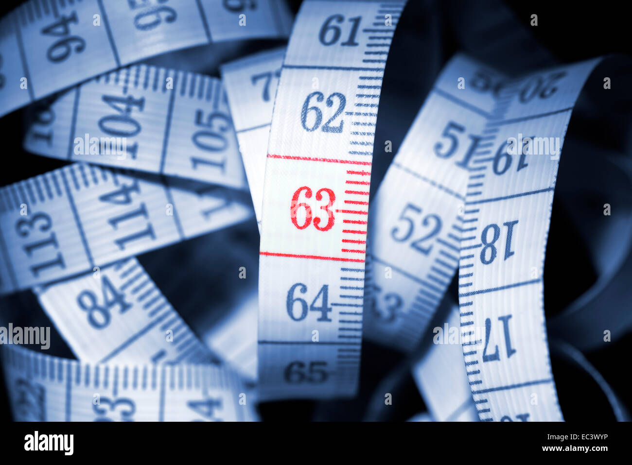 Number 63 on measuring tape, retirement pension at age 63 - Stock Image