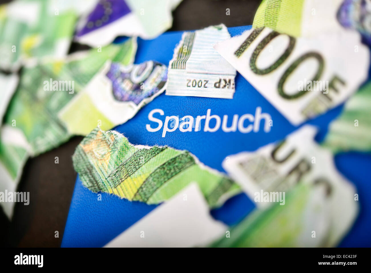 Torn euro bill and savings account, low interest rates - Stock Image