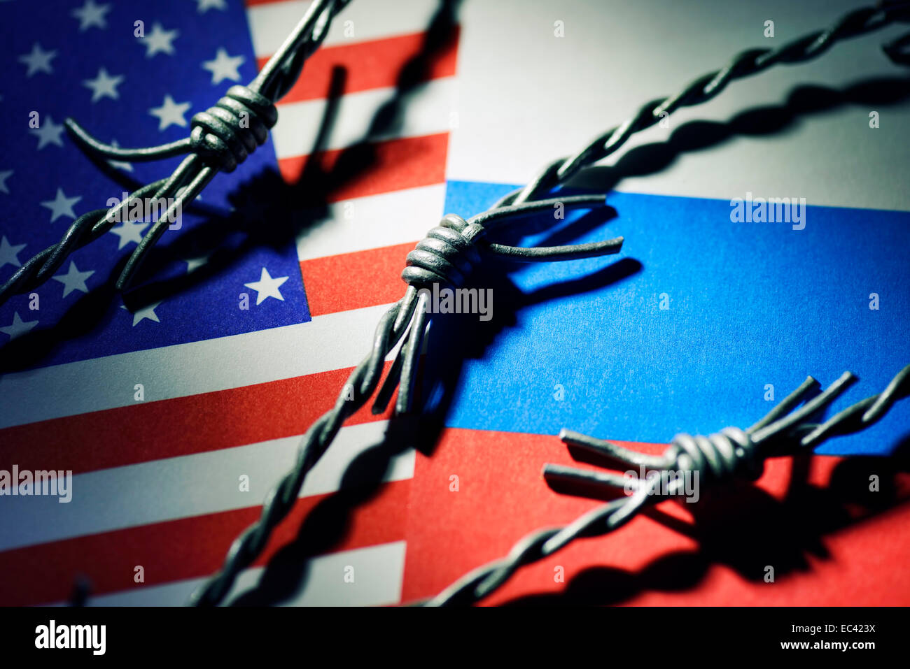 Flags of the USA and Russia with barbwire, cold war - Stock Image