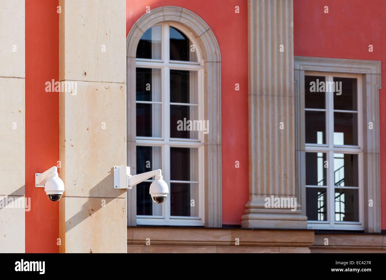 Surveillance camera on a public building Stock Photo