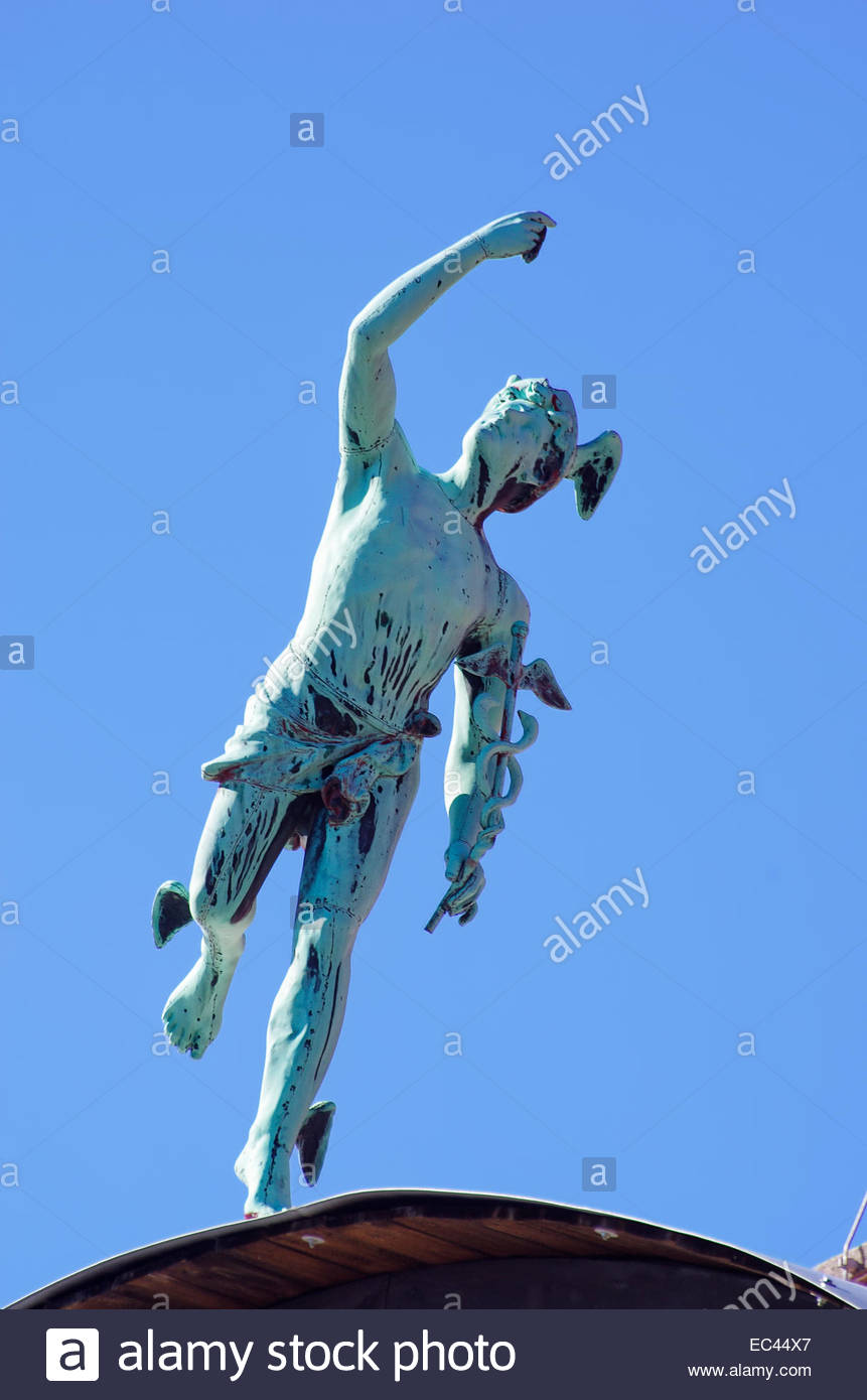 Greek God Hermes and Roman God Mercury on rooftop, Vrchlabi, Czechia. - Stock Image