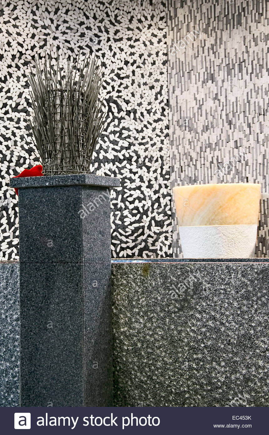 Bath room design of various natural stone material. - Stock Image