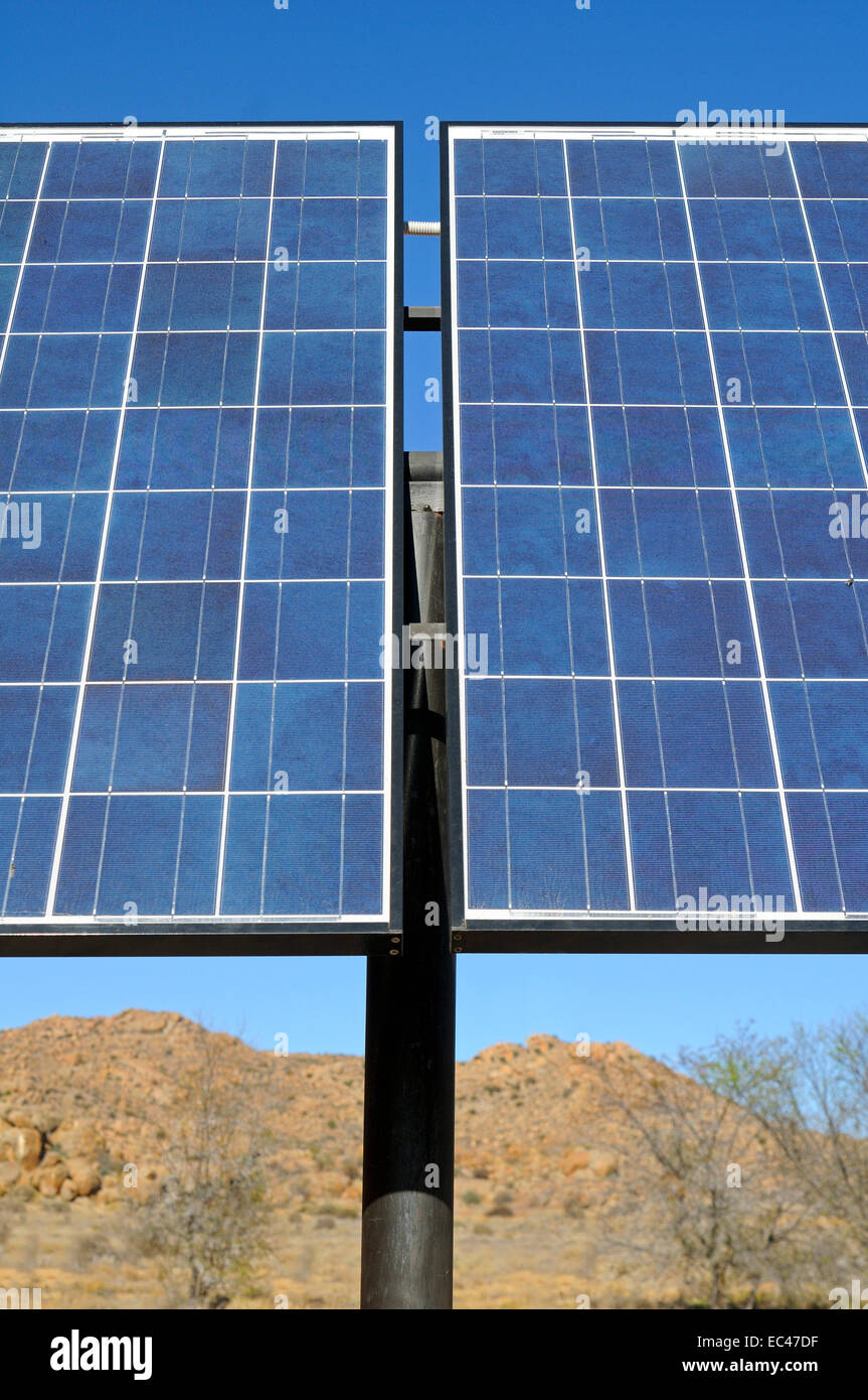 Solar panels in use in a semi-desert environment, South Africa - Stock Image