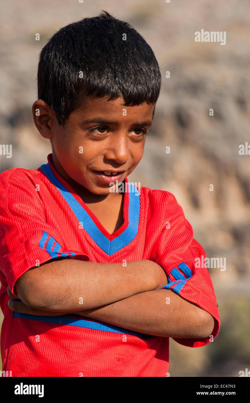 Portrait of a 7-year old boy, Al Ayn, Sultanate of Oman - Stock Image
