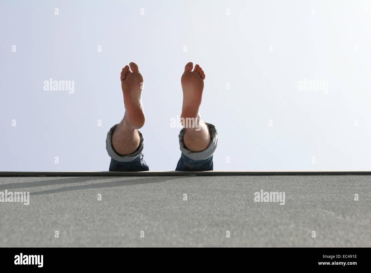 Dangle feet - Stock Image