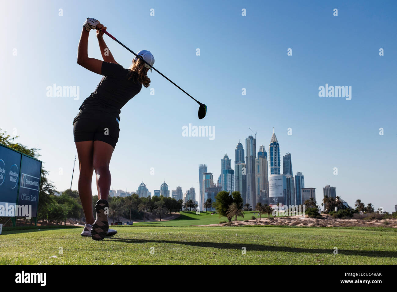 Dubai, United Arab Emirates. 9th December, 2014. Cheyenne Woods (niece of Tiger Woods) of the USA tees off from - Stock Image