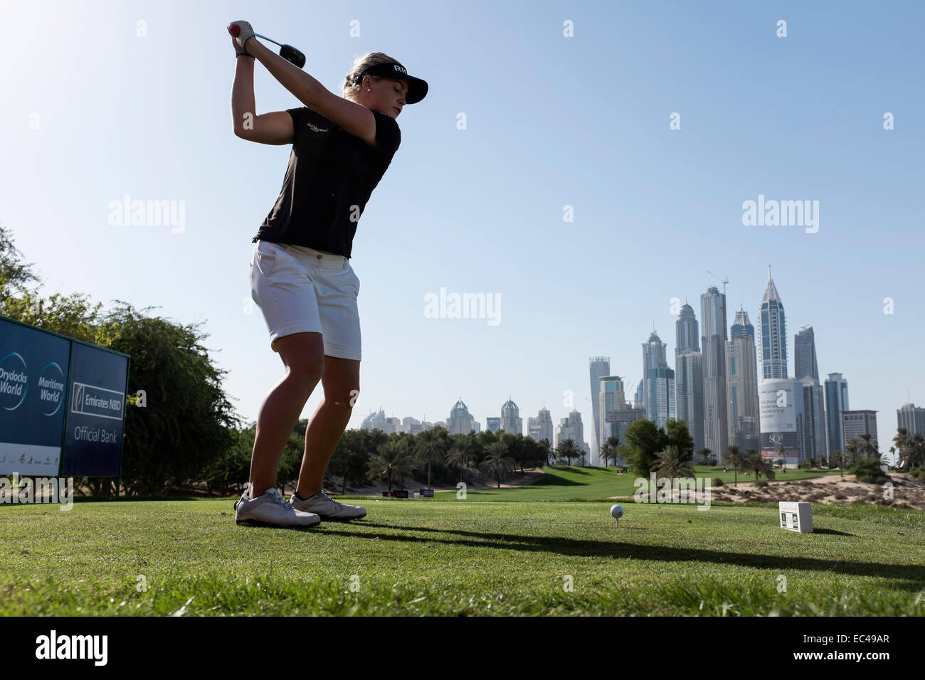 Dubai, United Arab Emirates. 9th December, 2014. Charley Hull of England tees off from 8th Tee at Emirates Golf - Stock Image