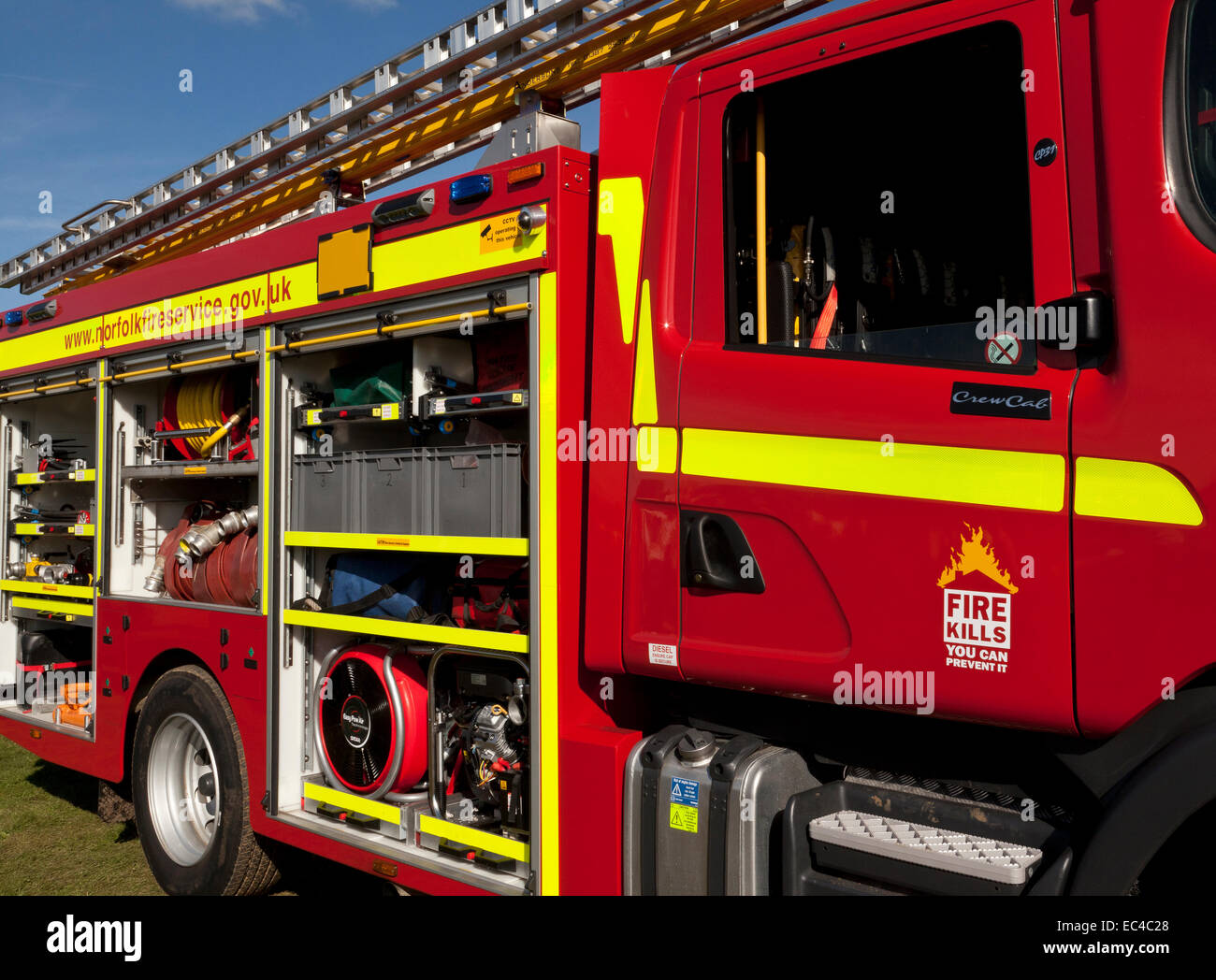 A fire engine showing all its equipment stowed on board - Stock Image