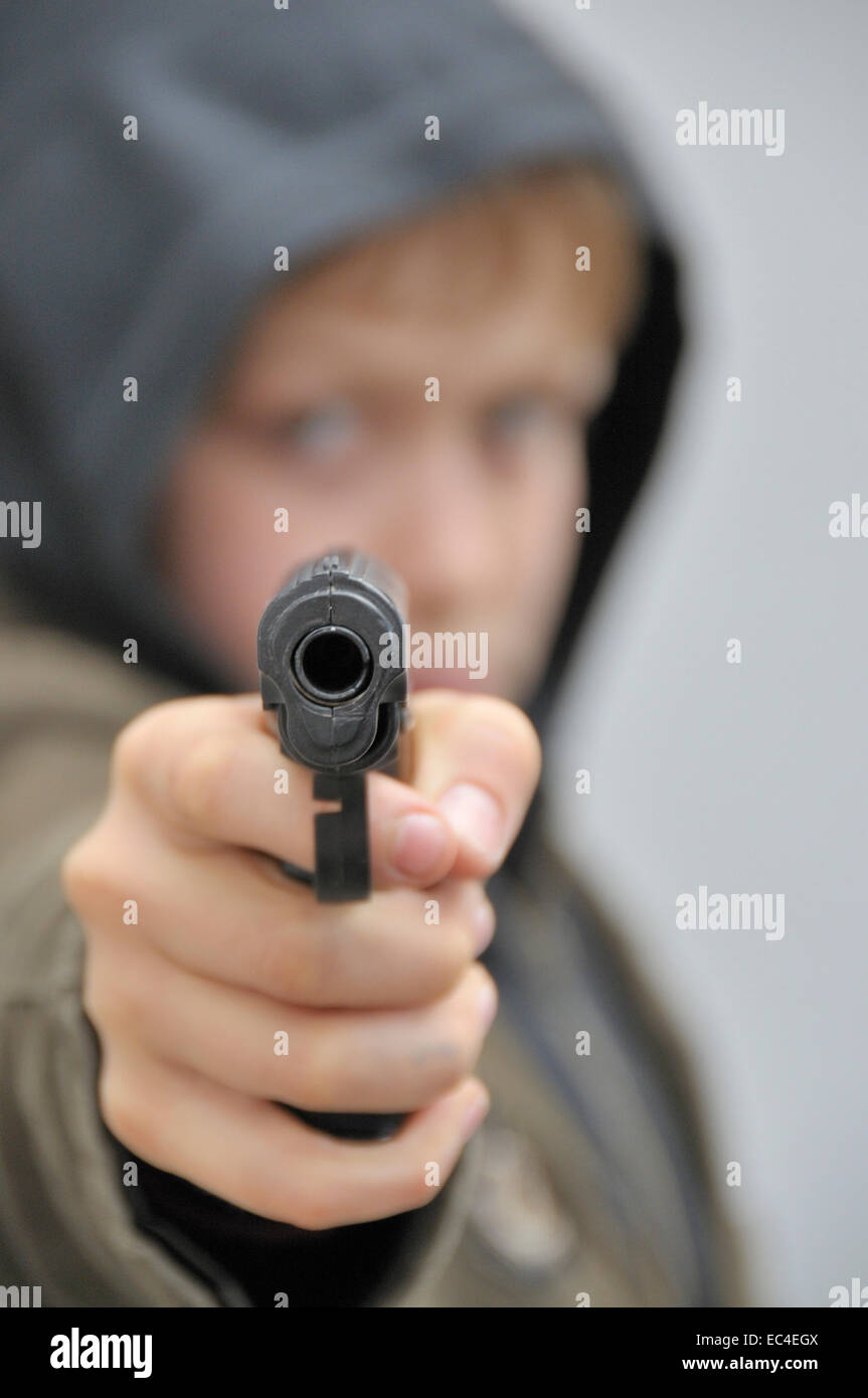 Ten year old boy with plastic pistol - Stock Image