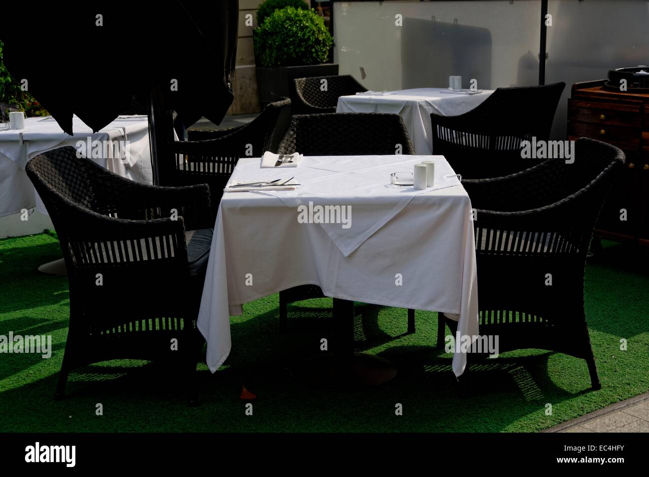 White black, table coverings outdoors for several people Stock Photo
