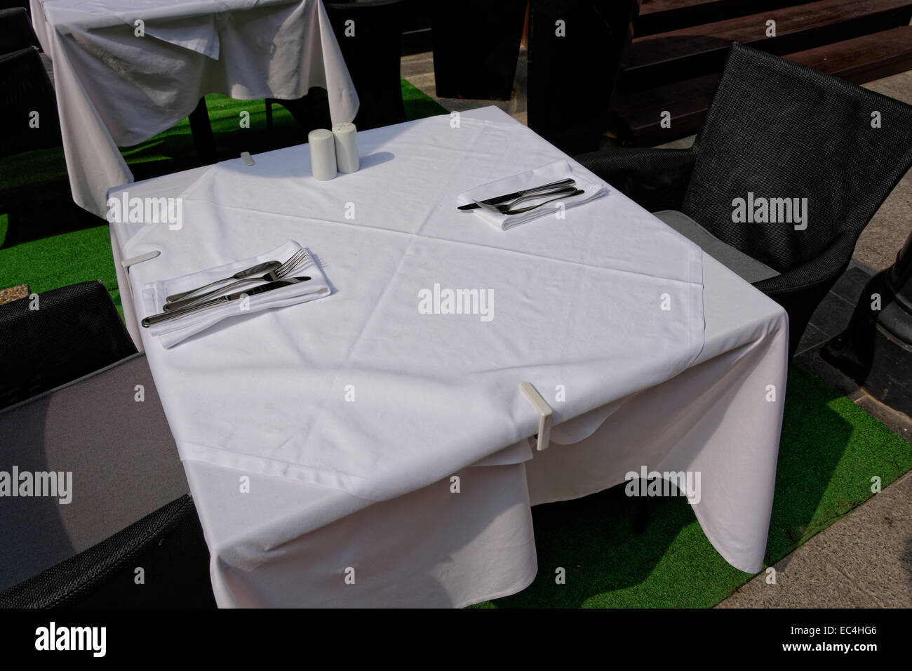White black, table covering outdoors for 2 persons - Stock Image