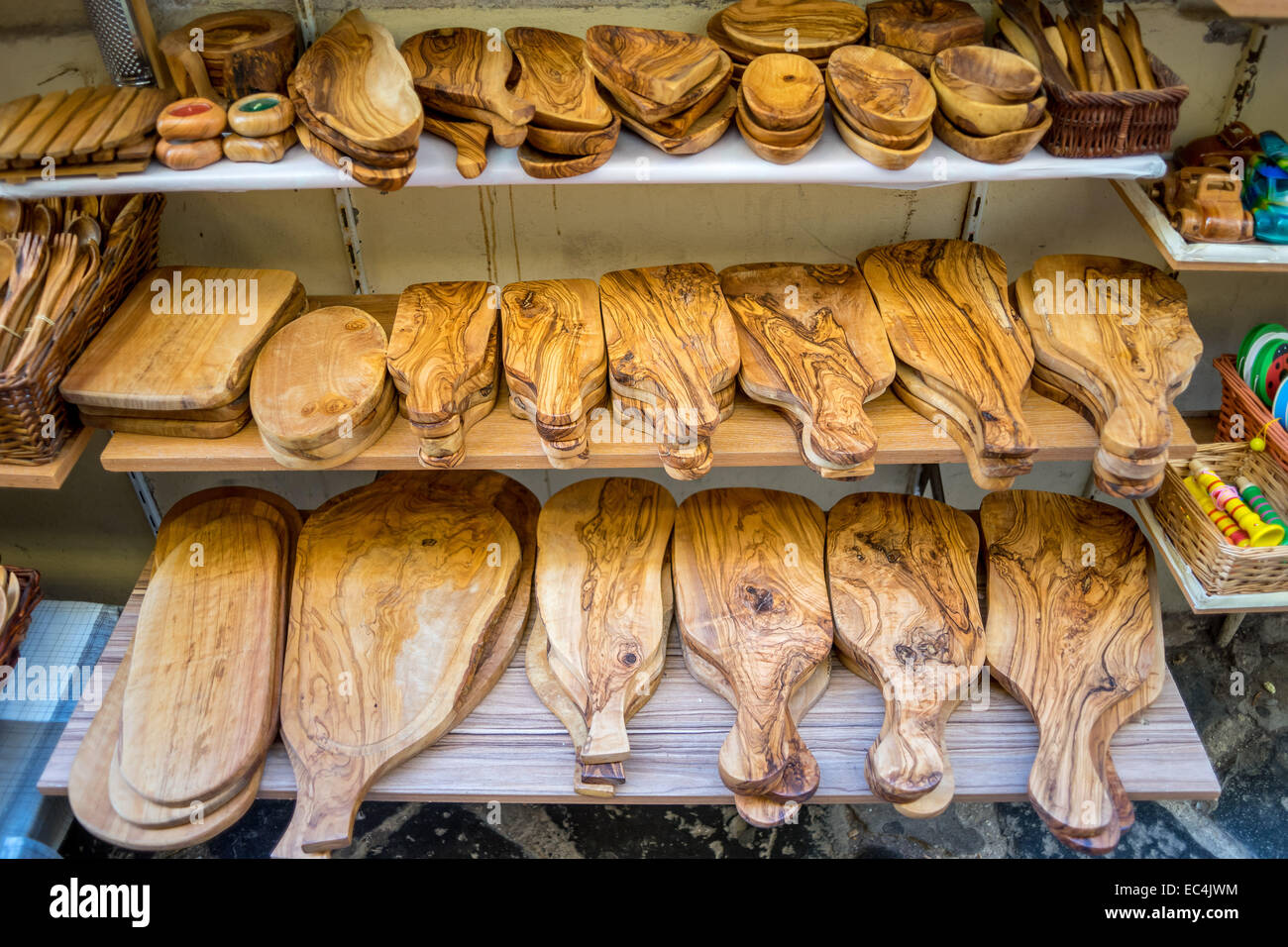 Cutting boards from olive wood Korfu Old Town - Stock Image