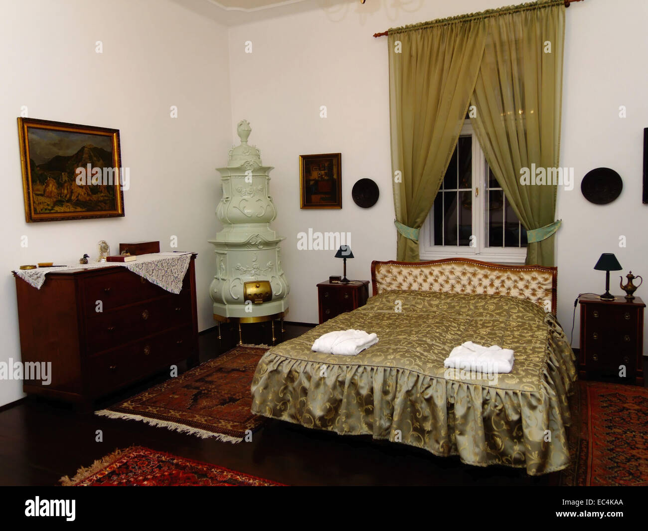 Bedrooms with tiled stove in the Schlosshotel of Pronay Hungary - Stock Image