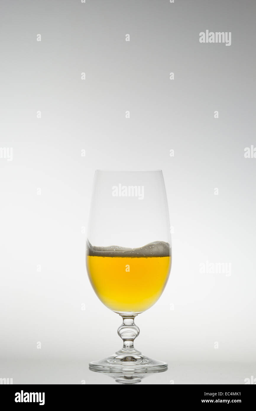 Beer in a glass with very little foam - Stock Image