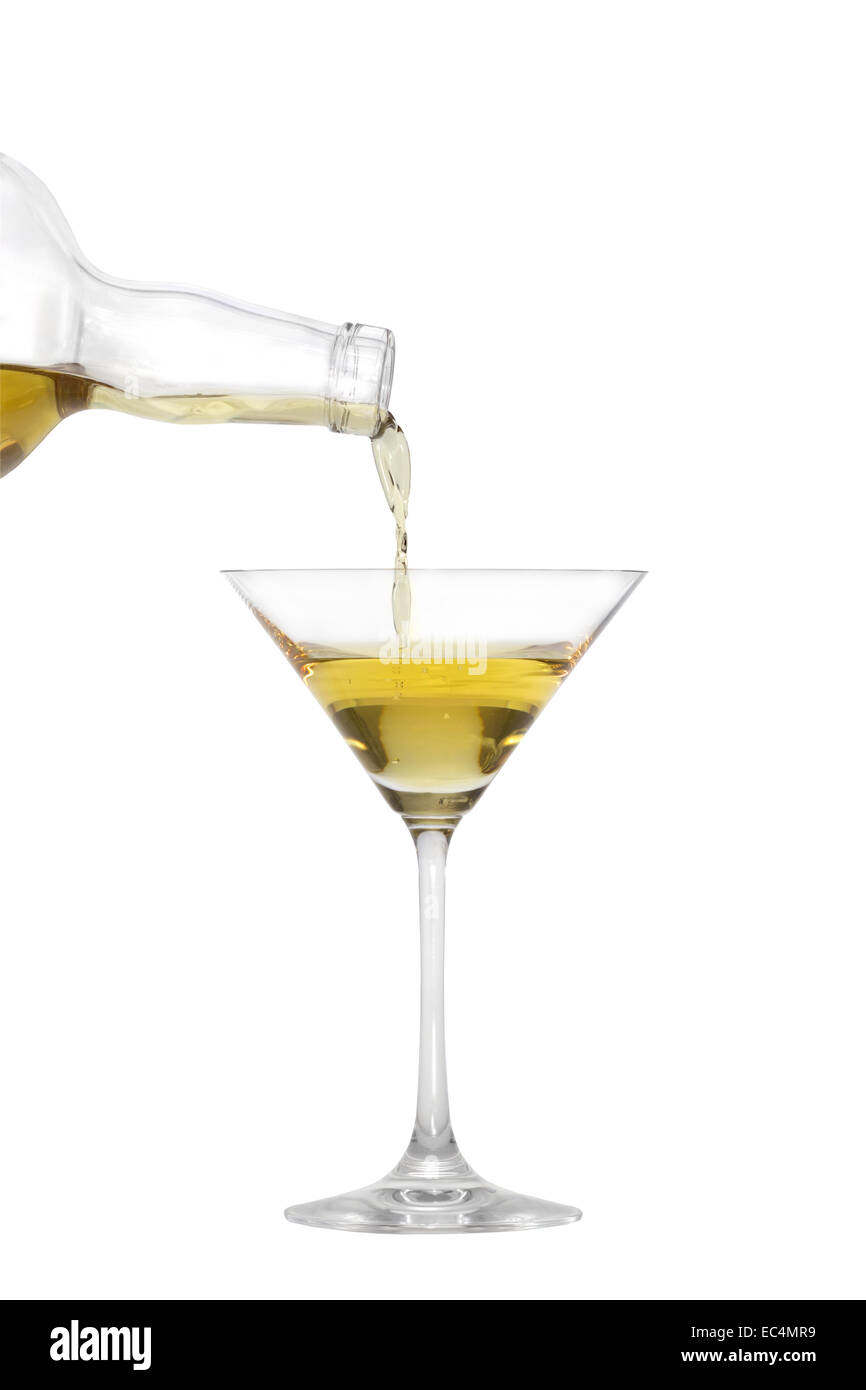Pouring a liquid into a Martini glass isolated on white - Stock Image