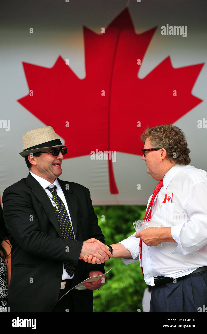 Canadian greeting stock photos canadian greeting stock images alamy men shaking hand in front of the canadian flag on canada day stock image m4hsunfo