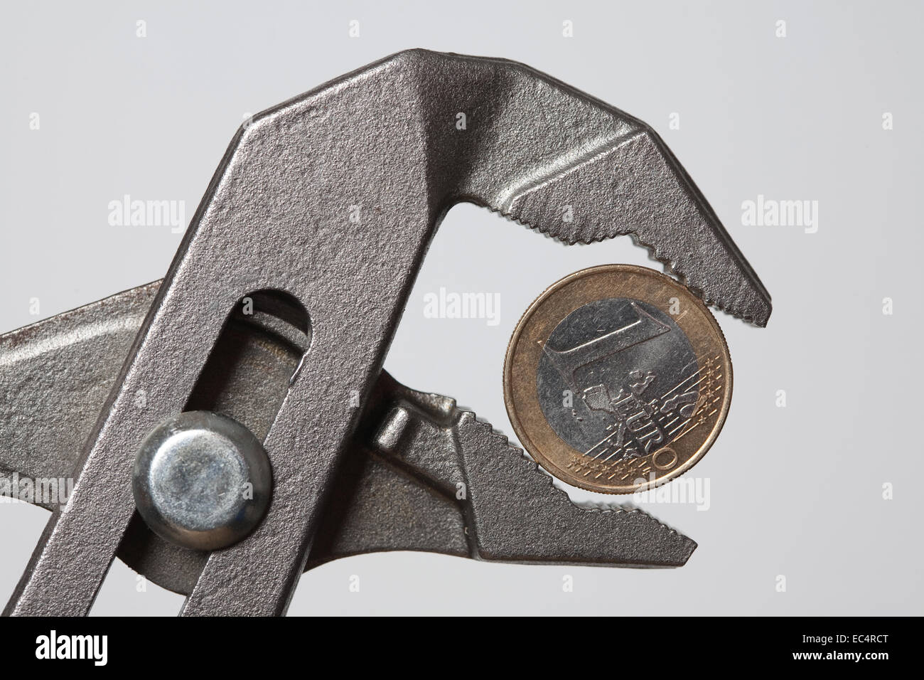 Euro in the pincer grip - Stock Image