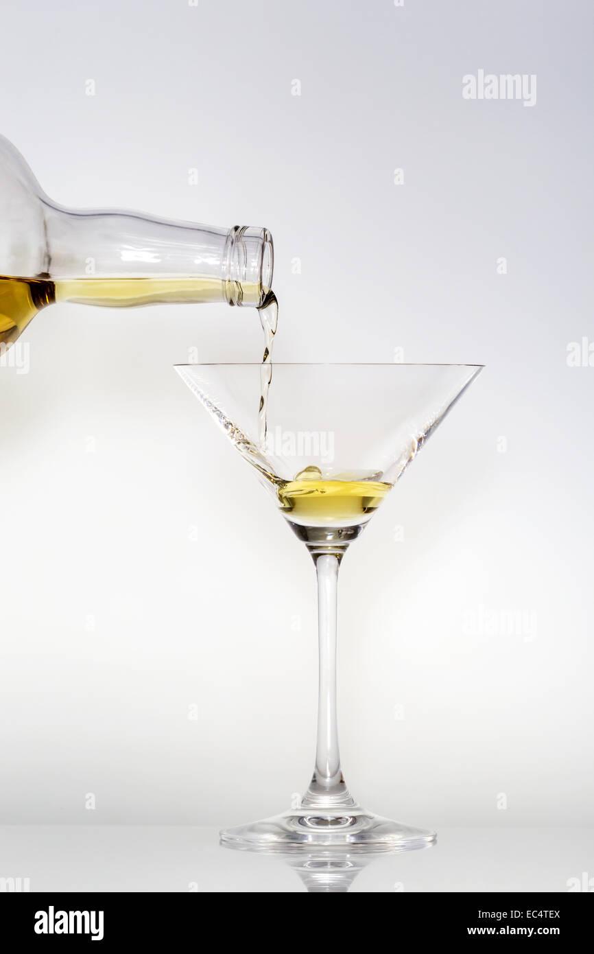Pouring a liquid into a Martini glass - Stock Image