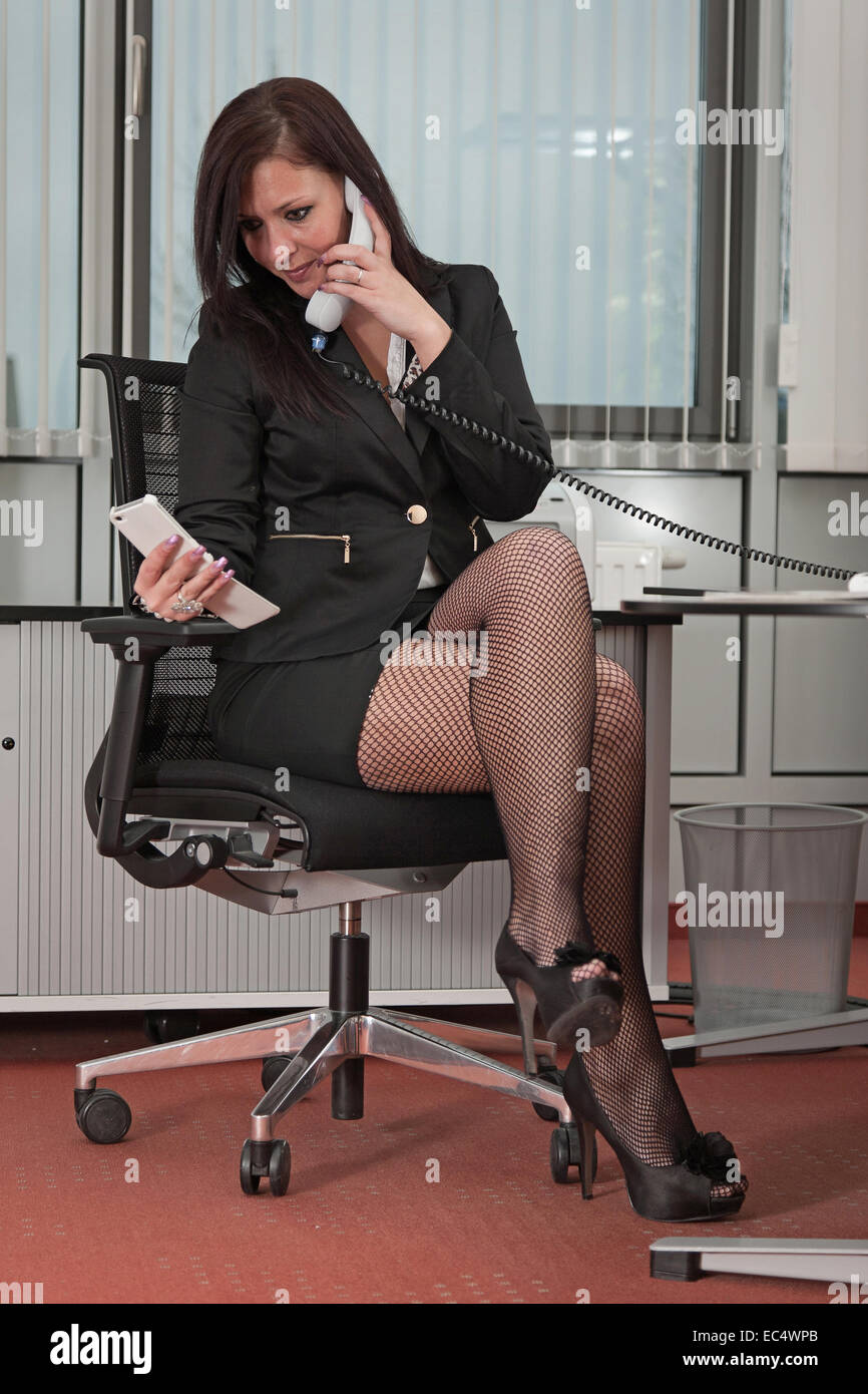 Pretty secretary in a stressful situation - Stock Image