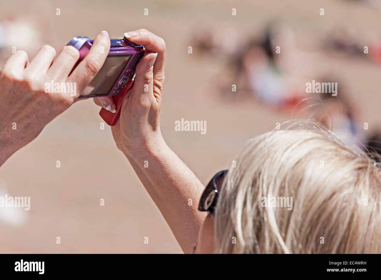 Young woman photographed with her digital camera - Stock Image