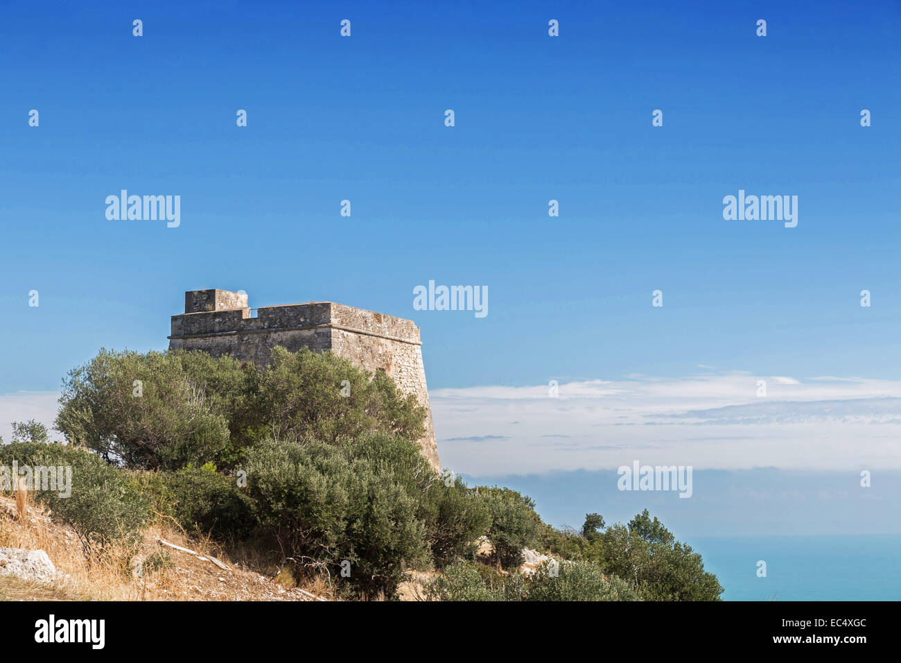 Mighty old watchtower on the Gargano coast - Stock Image
