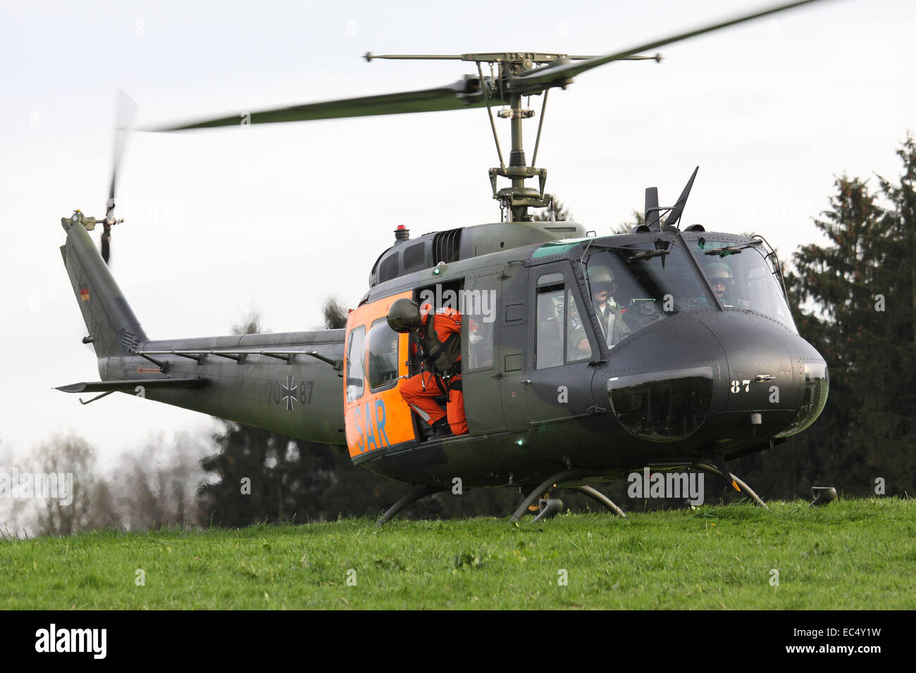 Closeup of the military helicopter with the Pilots - Stock Image