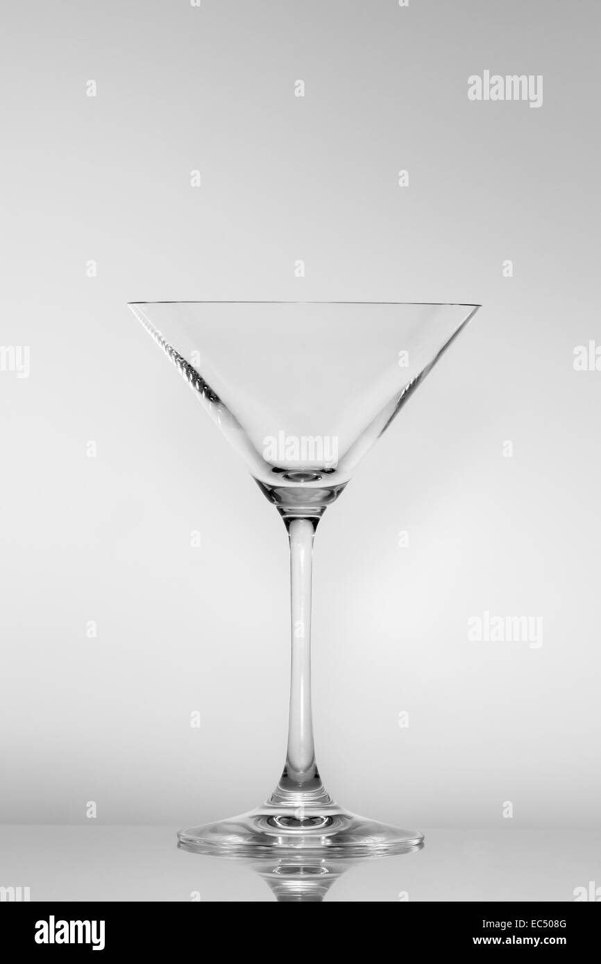 Empty Martini glass on a gray neutral background - Stock Image