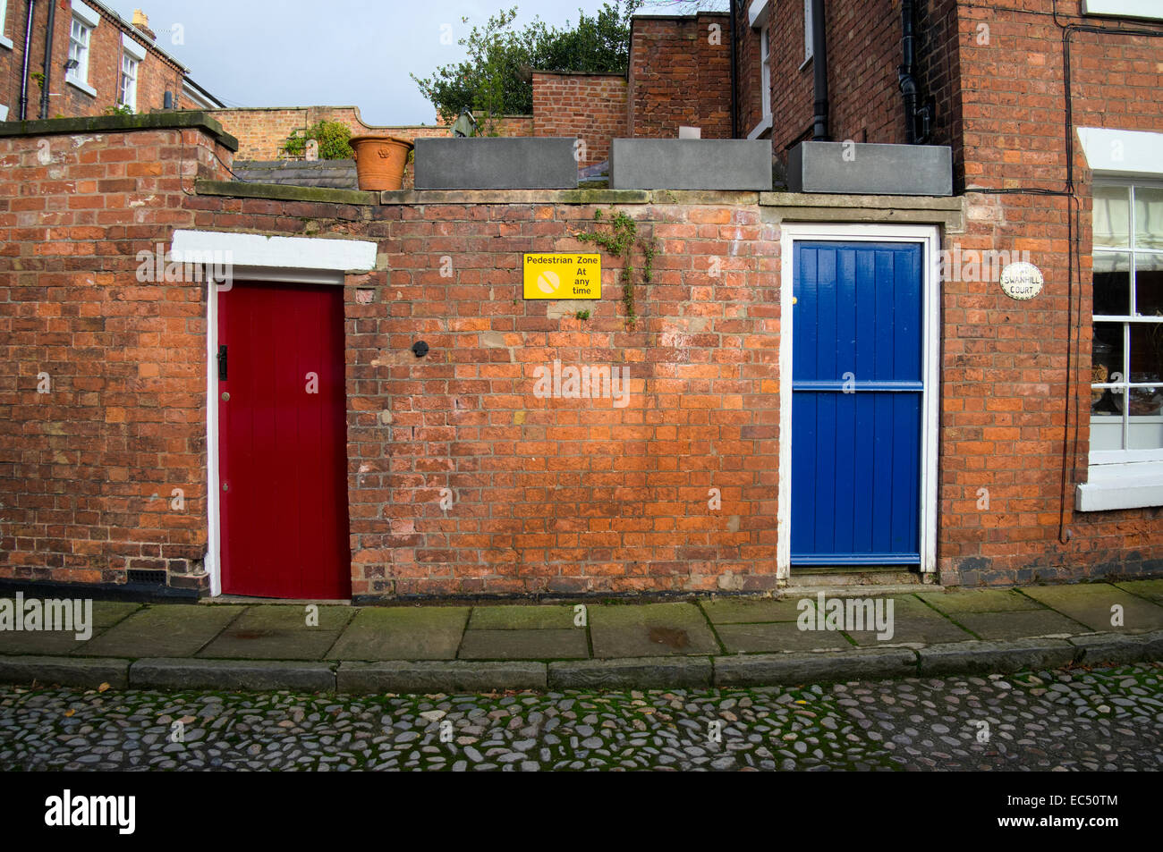 Blue and red wooden doors in a brick wall at Swan Hill Shrewsbury Shropshire & Red Wooden Doors Stock Photos u0026 Red Wooden Doors Stock Images - Alamy