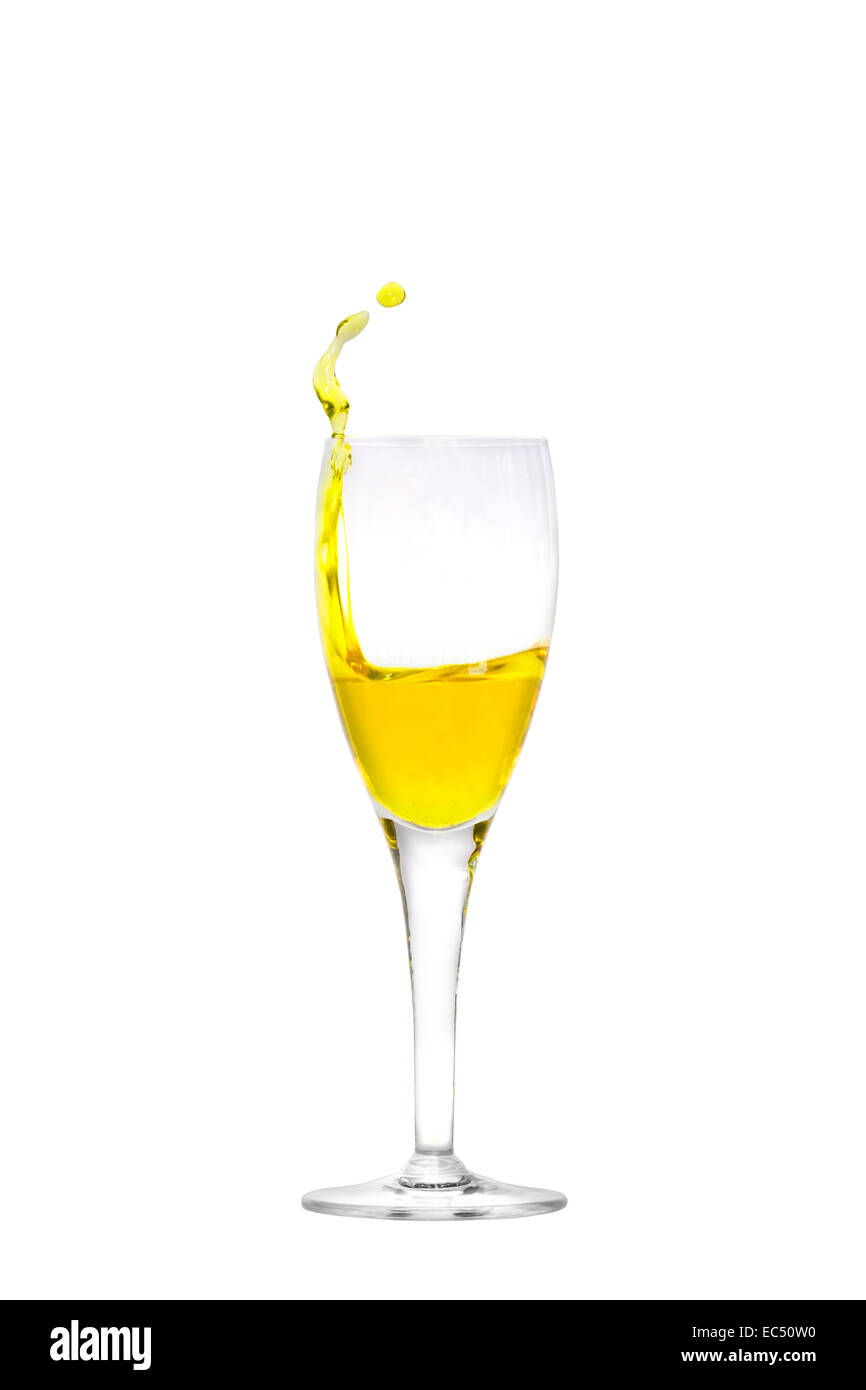 Isolated champagne flute with splashing liquid - Stock Image