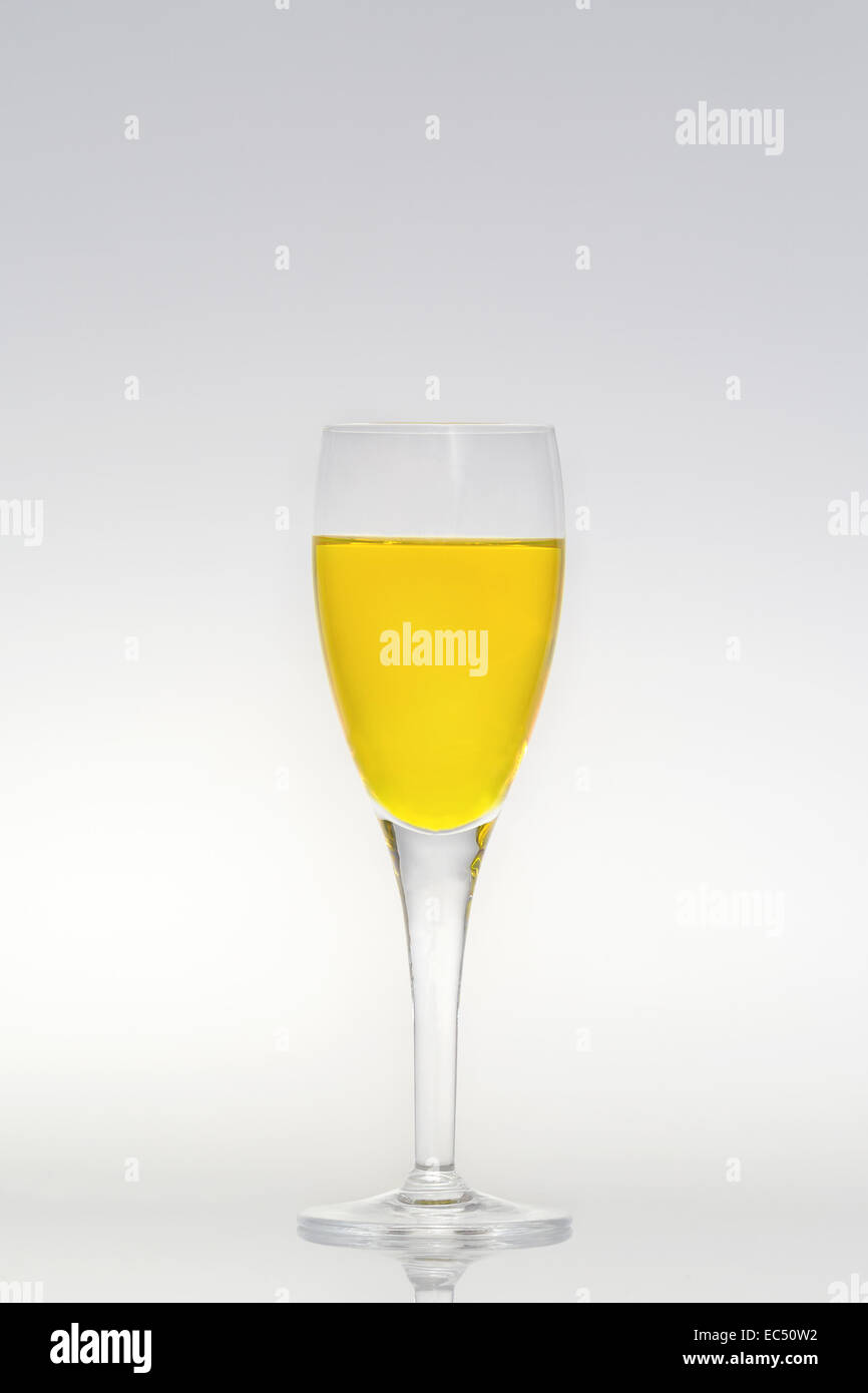 Filled champagne glass - Stock Image