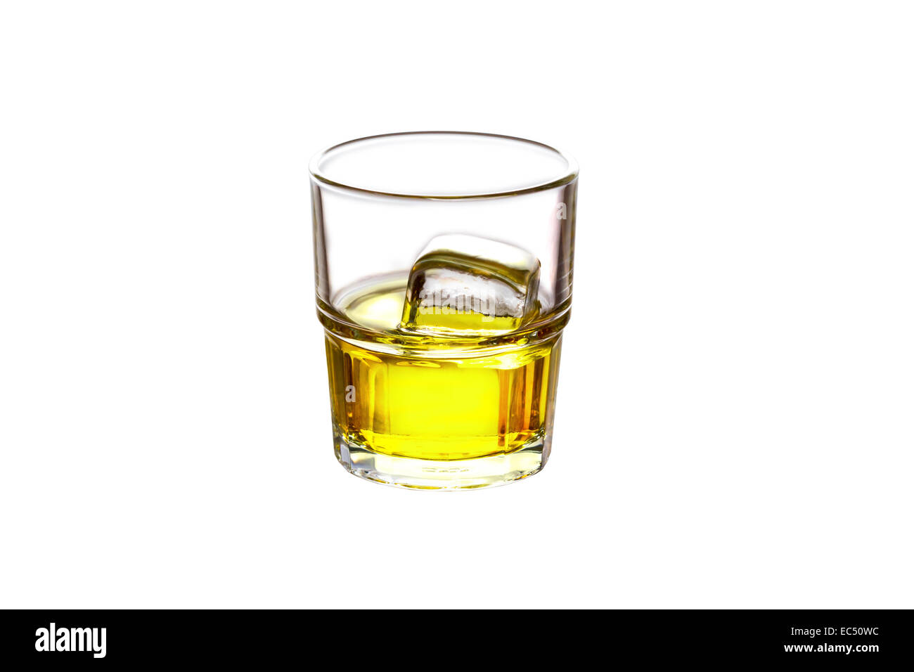 Glass filled with whiskey and ice isolated on white - Stock Image
