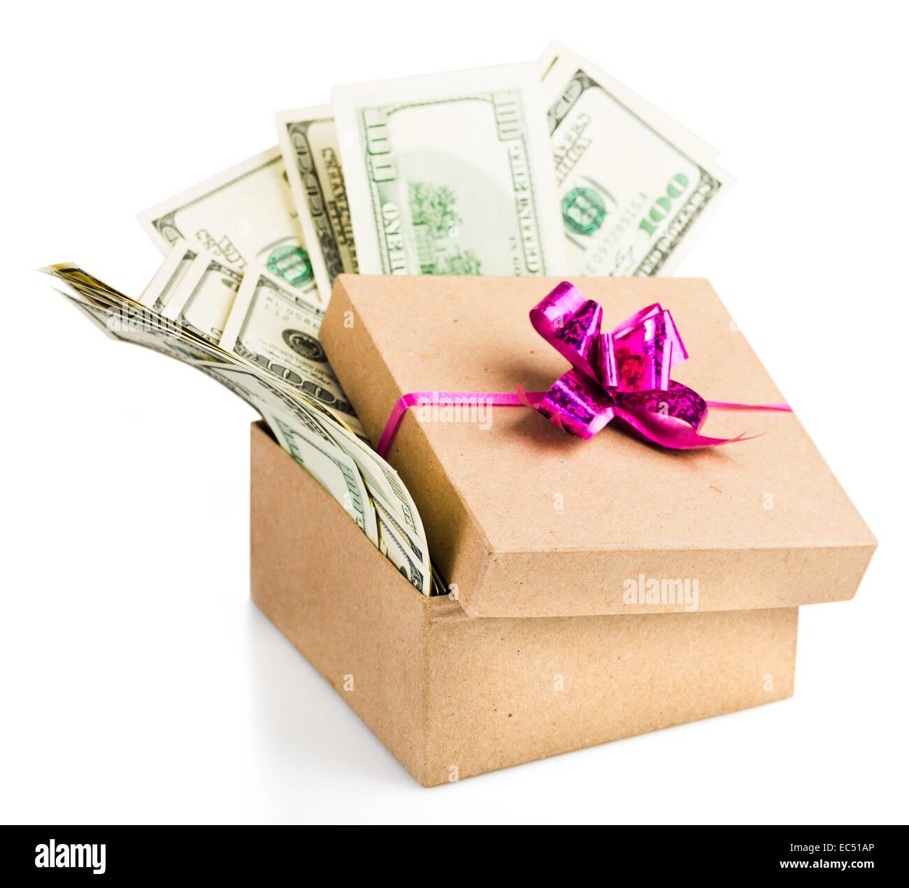 heap of hundred dollar bills in a big present box stock photo