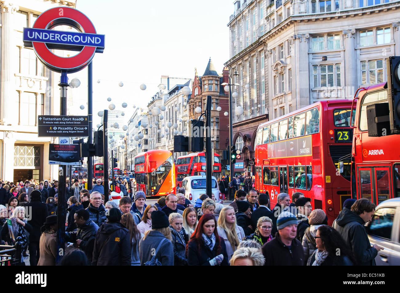 Shoppers near Piccadilly Circus tube station on Oxford Street, London England United Kingdom UK - Stock Image